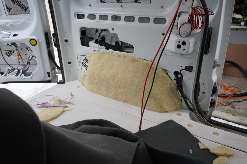 Insulating the wheel wells in Transit Connect 2010 van conversion