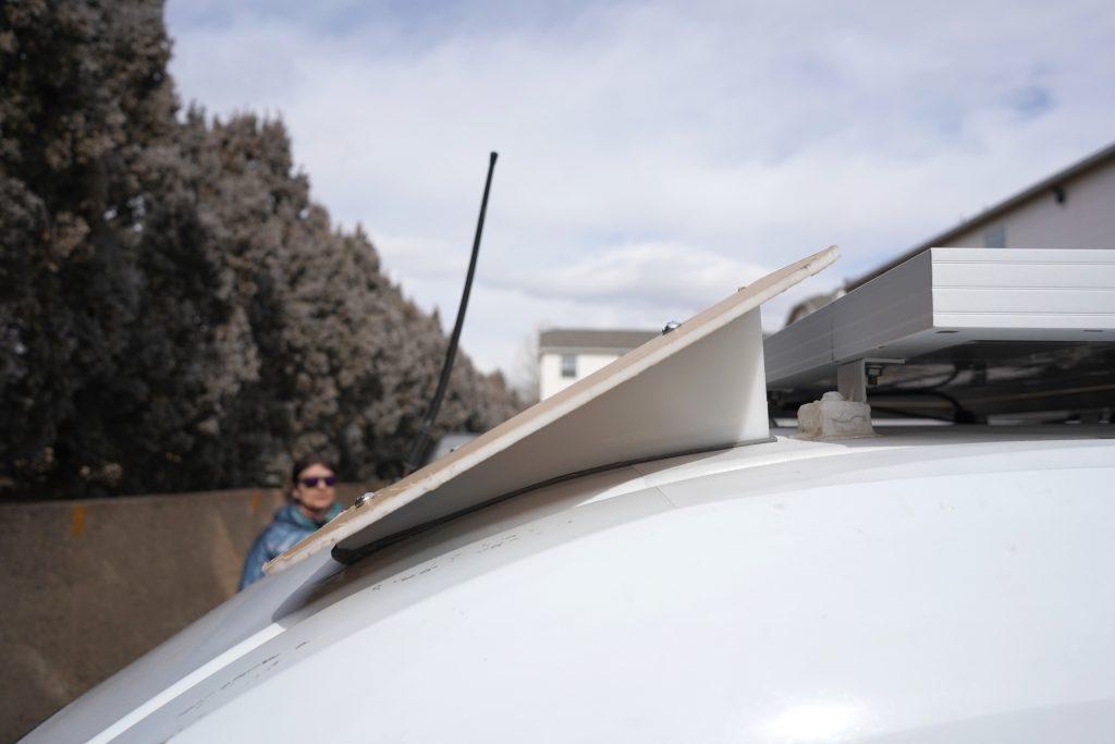 Custom wind fairing on Transit Connect 2010 van conversion